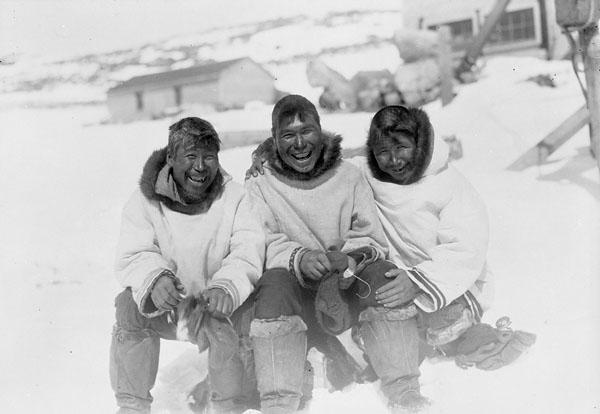 Three Inuit men after a hunt