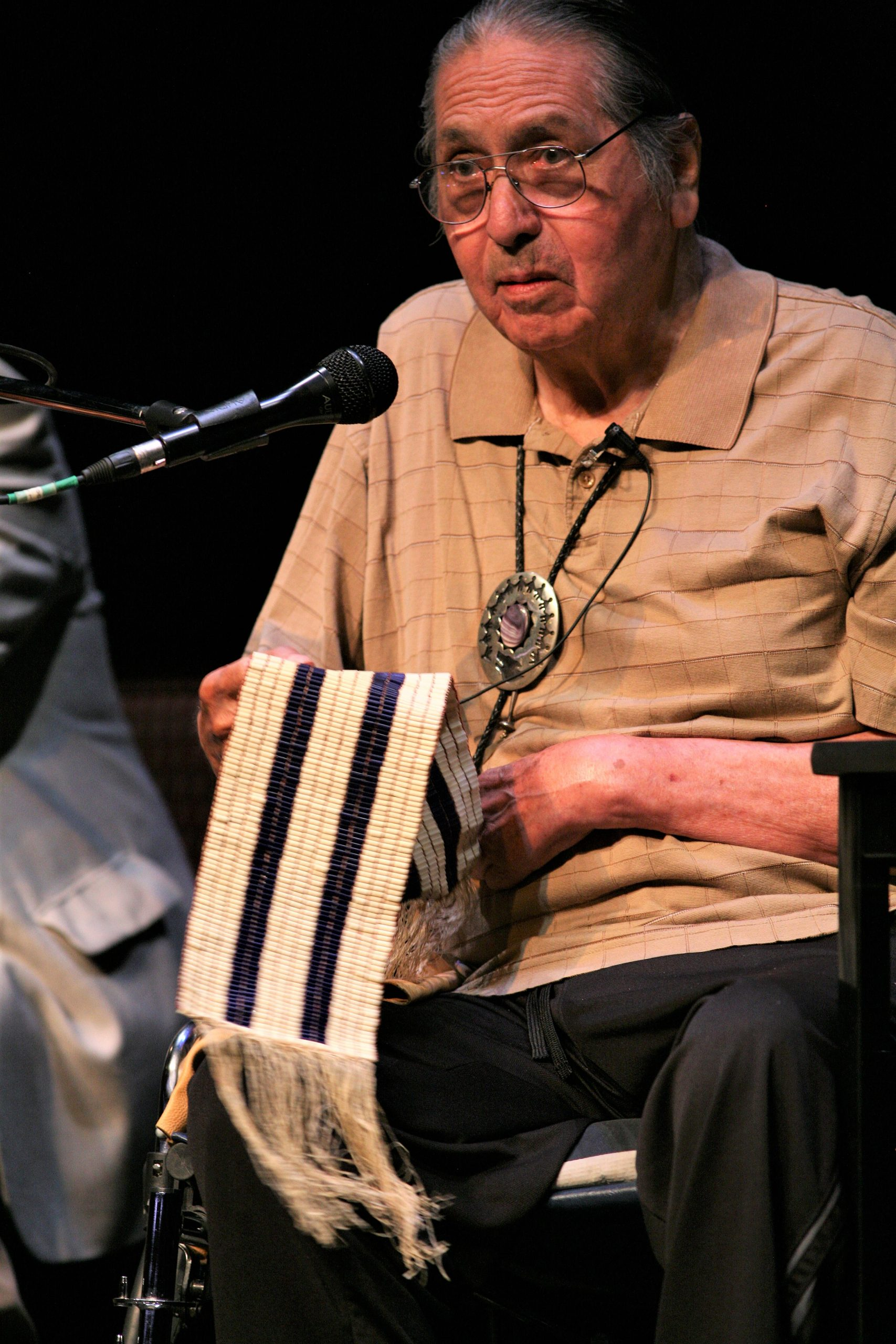Onondaga Nation Chief Irving Powless Jr. displaying the two row wampum belt.