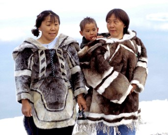 Women of Iglulik, Nunavut wearing traditional clothing of seal (left) and caribou (right). 1999. Photo by: Ansgar Walk