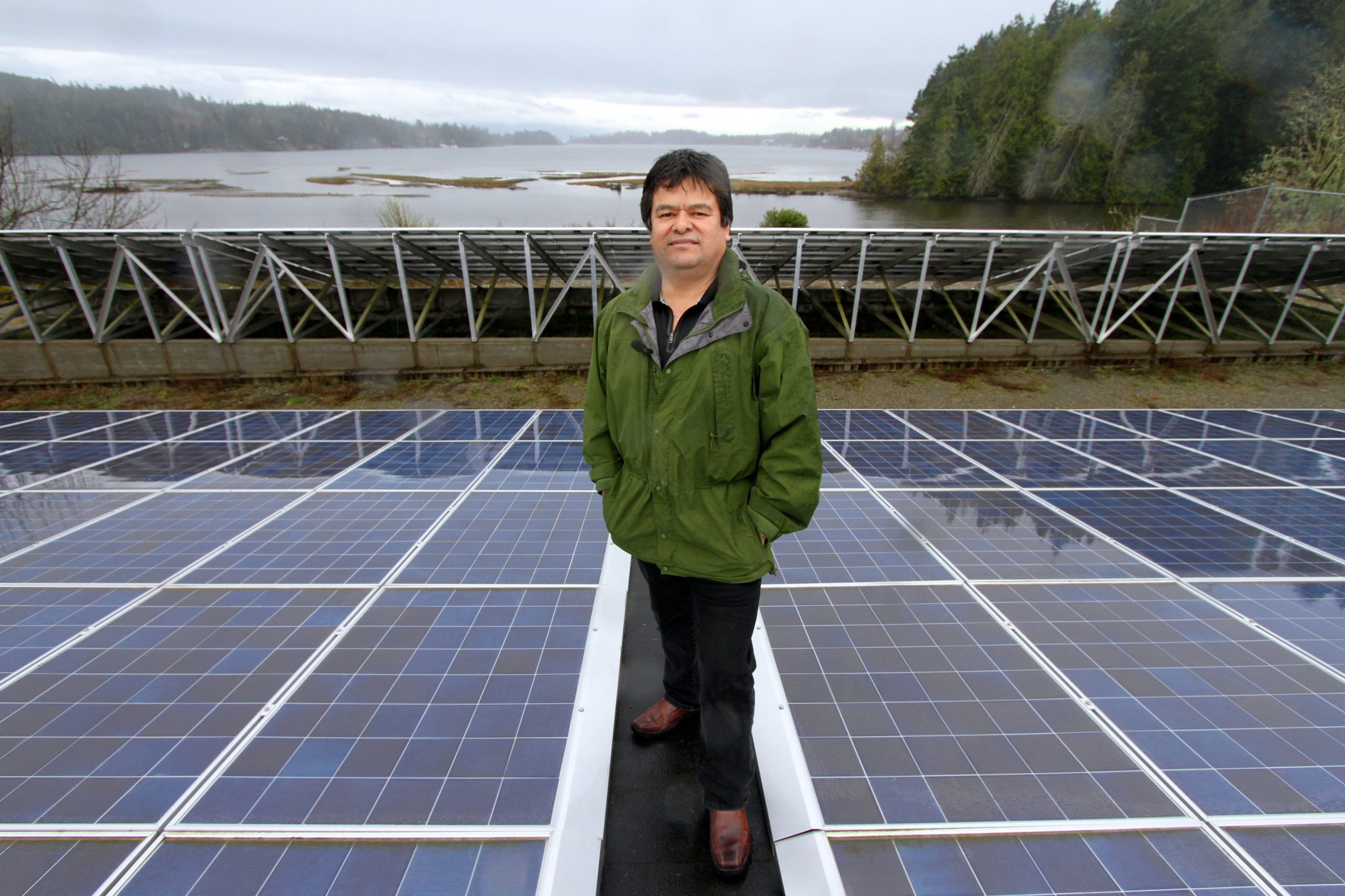 """Solar T'Souke – T'Sou-ke Chief Gordon Planes amongst a sea of solar modules on the canoe shed on Vancouver Island. For Chief Planes, using solar energy is like returning to his roots: """"Our people were dependent on the elements that the Creator gave us."""" Photo & Text Credits to: David Dodge/ Green Energy Futures. (CC BY-NC-SA 2.0) [157]"""
