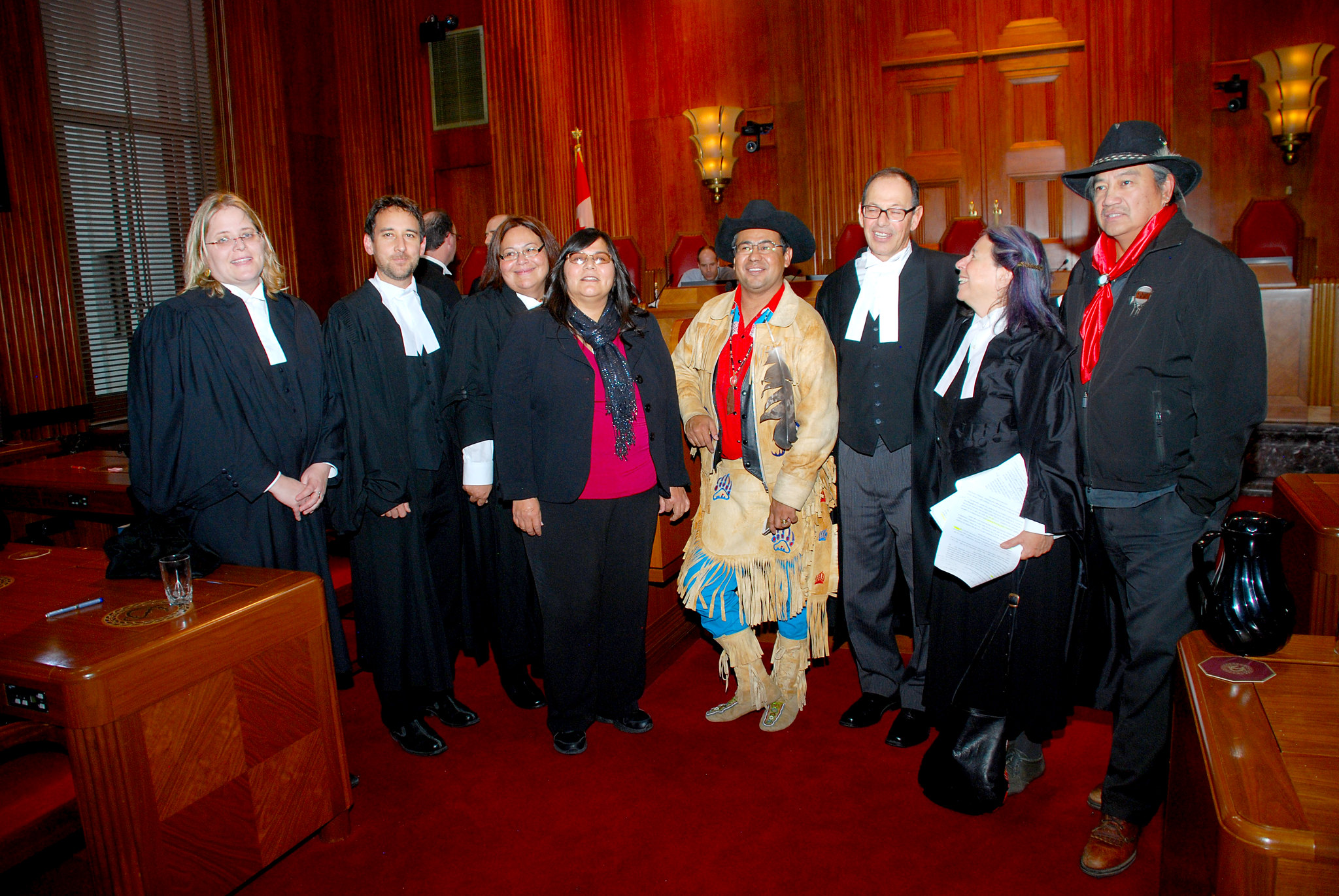 Tsilhqot'in and counsel with legal team representing the Secwepemc, Okanagan and Union of BC Indian Chiefs, Intervenors before the Supreme Court on Nov. 7, 2013. . Photo credits to: Thompson Rivers University (CC BY-NC-SA 2.0) [152]