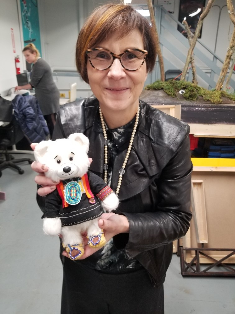 """Cindy Blackstock holding up a plush bear like the one which """"bears"""" witness during FNFCS court cases. Used with permission from Cindy Blackstock"""