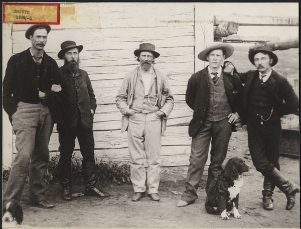 Group in position of power, Fort Pitt. Left to Right: Thomas Trueman Quinn, Indian Agent; Inspector Francis Jefferies Dickens, NWMP, son of the novelist in command of the Fort Pitt Detachment; James Keith Simpson, son of Sir George Simpson, the notable Governor of the Hudson's Bay Company; Frederick Stanley Simpson, HBC clerk, Fort Pitt; Angus McKay, Post Manager, HBC, Fort Pitt, 1884 Credits to: Library and Archives Canada