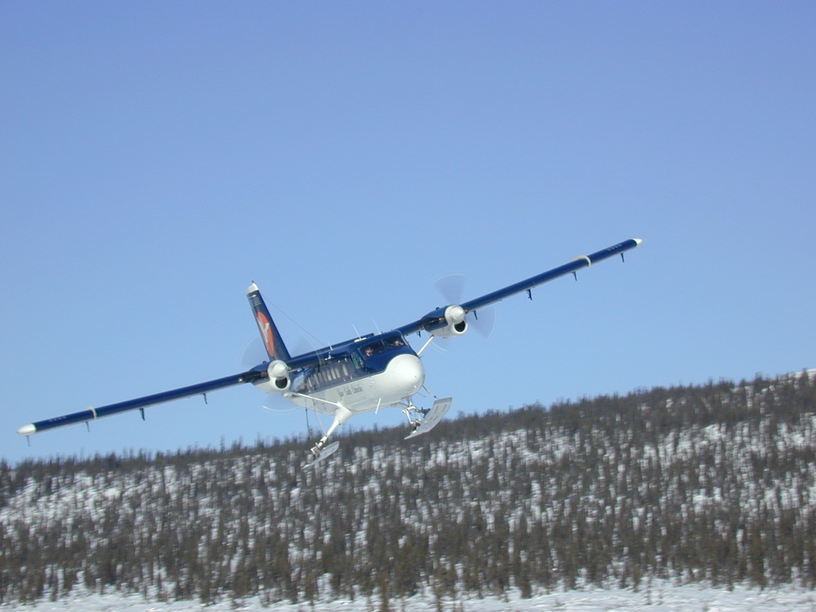 """DeHavilland DC-6 """"Twin Otter"""". Northern Canada has always relied on bush planes and pilots to transport people and supplies. Credits to: Sahtu Wildlife (CC BY-NC 2.0) [173]"""