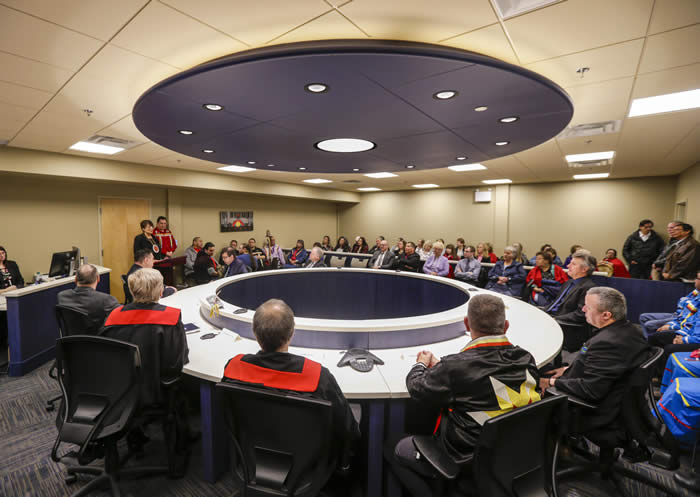 Gladue Courthouse in Wagmatcook First Nation. Members of the court team and First Nations leaders gather in the new courtroom in Wagmatcook on the first day of operations (April 4, 2018) Credits to: Provincial Courts of Nova Scotia/Wagmatcook First Nation. Used with permission from: Wagmatcook First Nation [173]