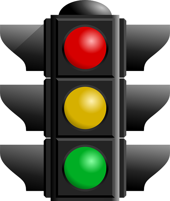 image of a traffic light with green on the bottom, yellow at the centre, and red at the top