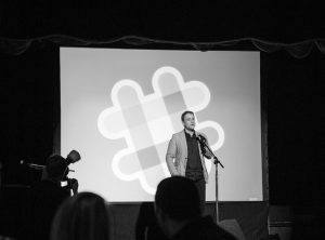 image of a presenter with a large slide behind him, an image of a hashtag