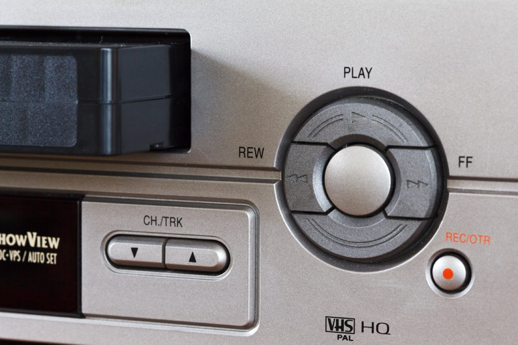 close up photo of controls for a video cassette player