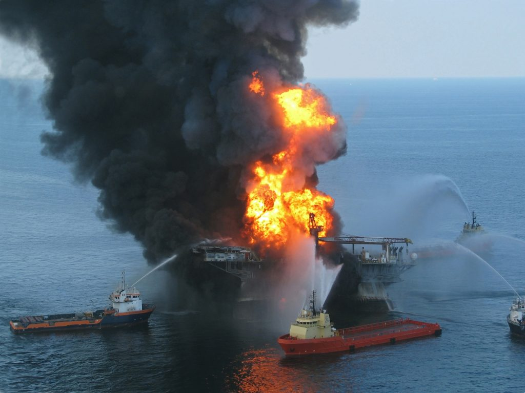 Photograph of boats fighting the fire from an explosion at the Deepwater Horizon drilling rig.