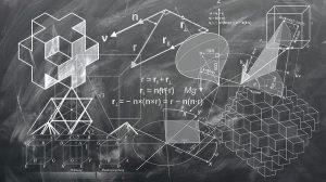 Math geometry figures on a chalk board.