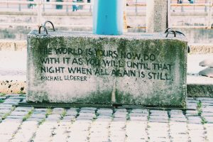 Street Art - cement block with a quote on it.