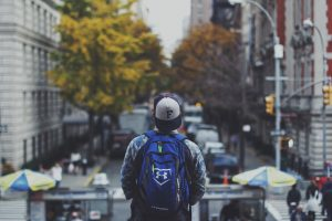 Man with backpack on street.