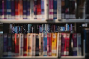 Photo of library shelves with books.