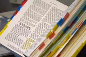Book with tabs and highlights.