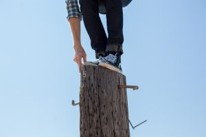 Man balancing on a pole.