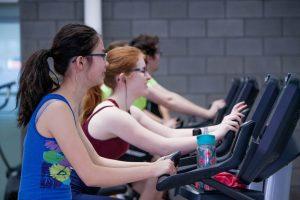 Two women on treadmills.