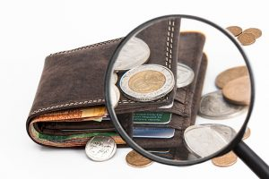 Wallet with bills and coins.