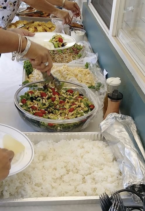 Dishes of rice, vegetables, and other foods