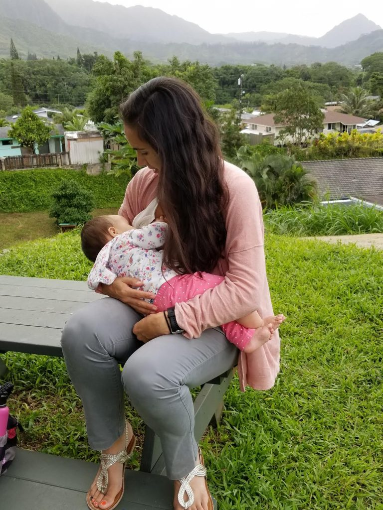 Woman breastfeeding an infant