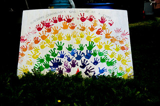 Hands in every colour of the rainbow to illustrate building community
