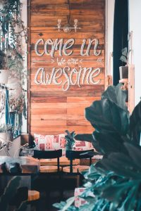 """A welcome sign that reads """"Come in, we are awesome."""""""