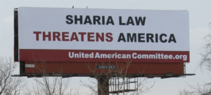 billboard with the words Sharia Law Threatens America