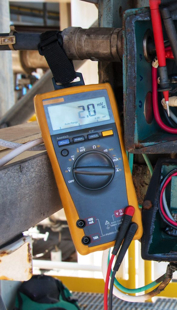 Multimeter that is safely tethered to a pipe