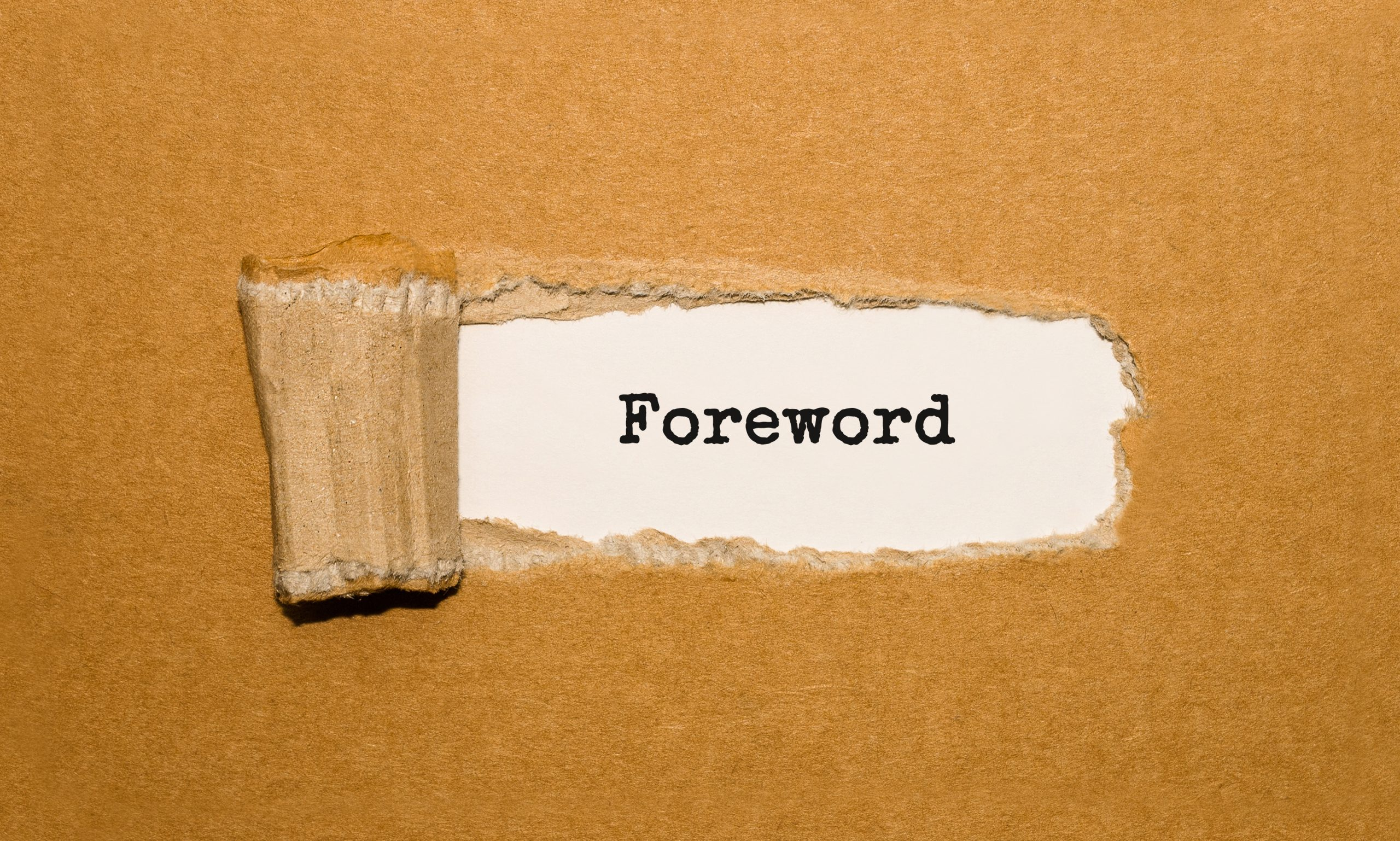 The text Foreword appearing behind torn brown paper